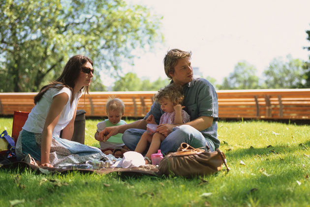 Jamie, Jools and their kids in a park