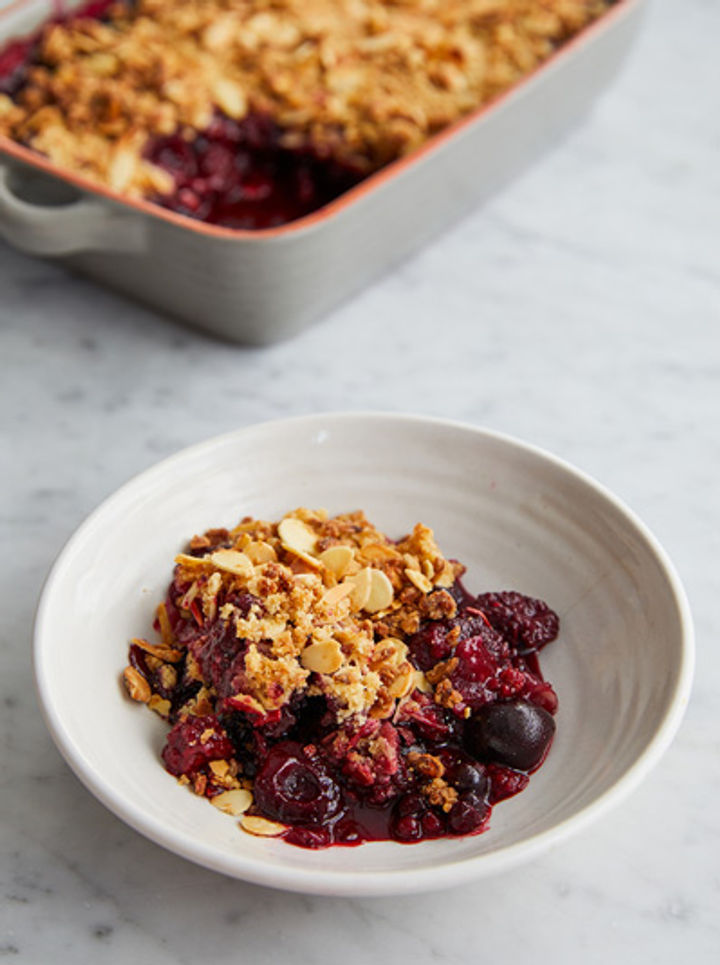 Bowl of frozen fruit crumble