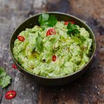 A bowl of guacamole, a great snack for kids