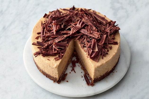 Banoffee cheesecake with chocolate curls on top, from our favourite cheesecake recipes