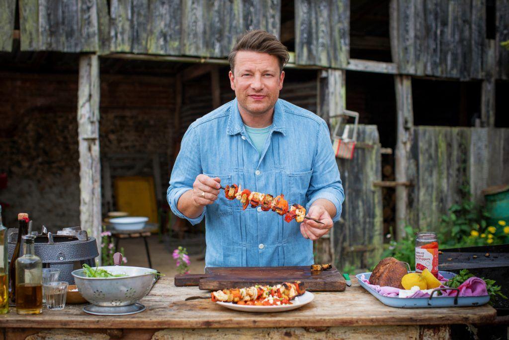 Jamie holding a prawn kebab