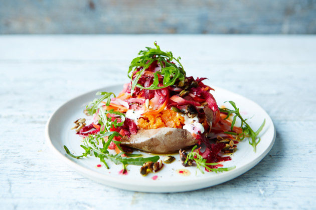 baked sweet potato with lettuce and beetroot shredded on top
