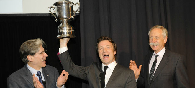 jamie oliver holding trophy at event