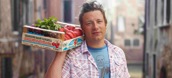 inspired by italy - Jamie holding fresh vegetables in a box