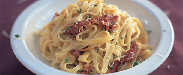 carbonara recipe, pasta with meat, cheese and herbs on top