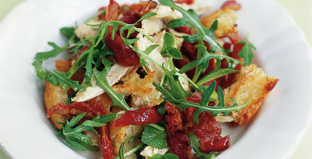 salad with croutons and roasted tomatoes and chicken