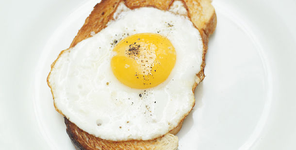 fried egg on toast with pepper