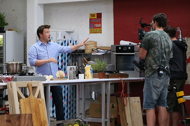 jamie oliver being filmed on set cooking