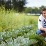 jamie oliver in a vegetable garden with a basket