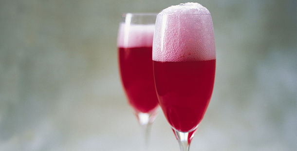 red champagne cocktail with foam on top