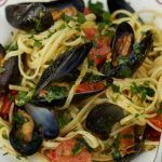 mussel linguine pasta dish with tomatoes and herbs