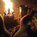 camping stove with flask next to it
