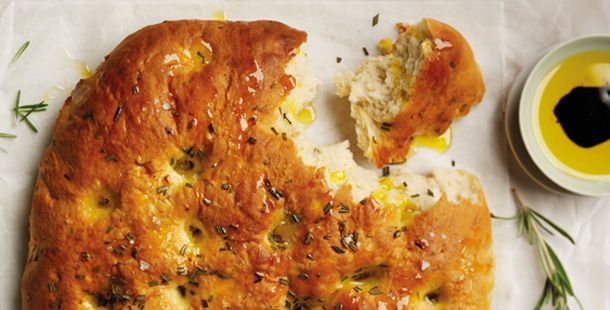 focaccia with herbs on top and balsamic vinegar in oil for dipping