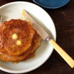 gluten-free pancakes with melted butter on top and syrup