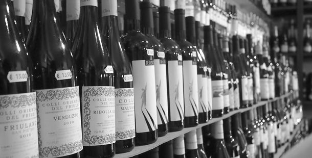 wine in a row on shelves