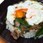 poached egg on rice and mushroom veggie stir fry dish