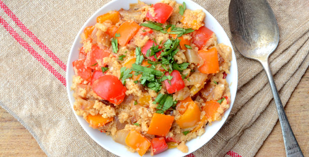 rice dish with red peppers and herbs sprinkled on top