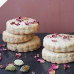 indian shortbread cookies with edible flowers on top