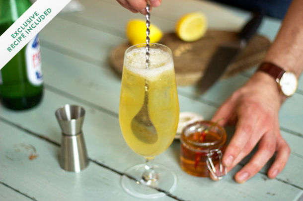 Oliver's twist cocktail recipe being stirred with honey on the side