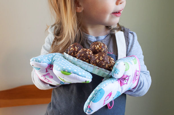 child holding plate with chocolate bakes