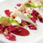 artichoke with feta on a berry jous