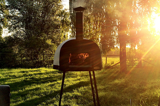 wood-fired oven outdoors in field