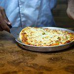 pizza made in dubai in a tray