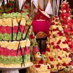 colourful, decorated cakes with tiers and colorful icing