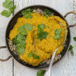 tarka dhal lentils with coriander on top and rice underneath