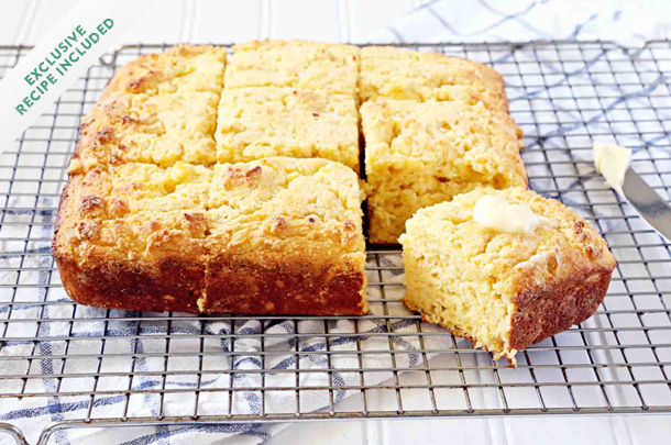 cornbread sliced into squares with butter on top