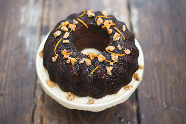 honey cake with nuts on top and orange zest