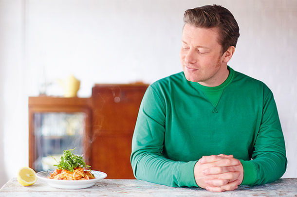 jamie staring at a plate of tomato salad