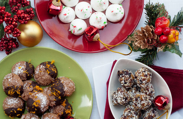 christmas desserts, truffles, cookies and baubles on a table