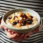 porridge oats with cinnamon sprinkled on apple and berries