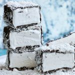 lamington ice cream bars with coconut shavings on top