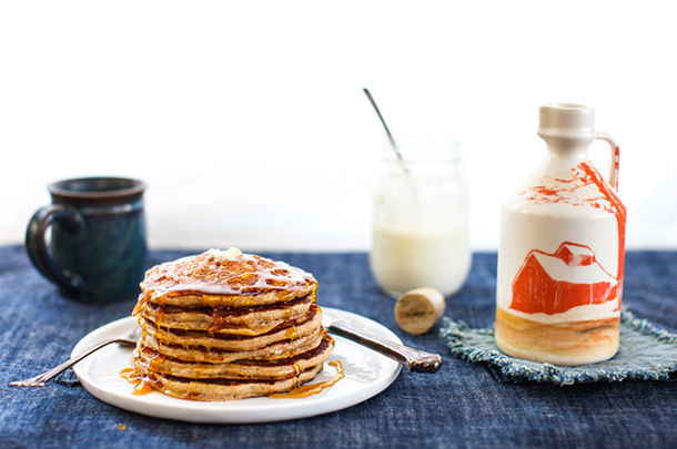 perfect pancakes - stack of pancakes with butter and syrup