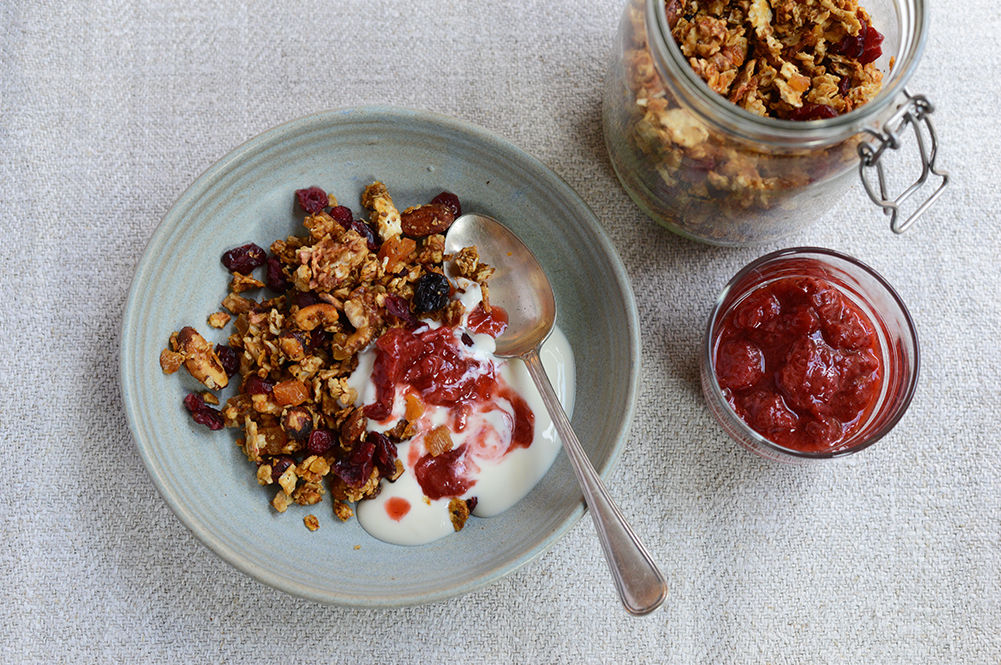 grains, granola and dried fruit with yoghurt and jam