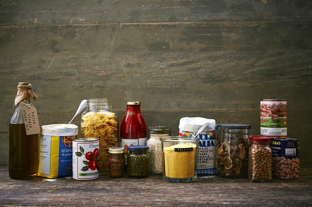selection of jars and cans with labels on - italian ingredients