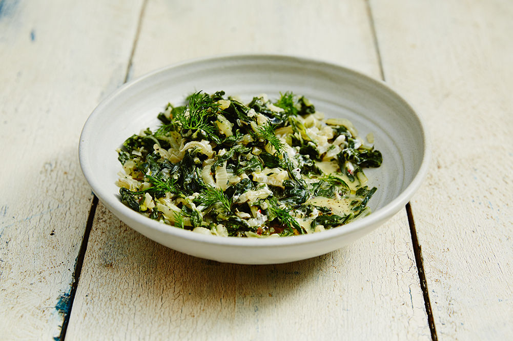 eating well in pregnancy - a bowl of salad leaves in sauce