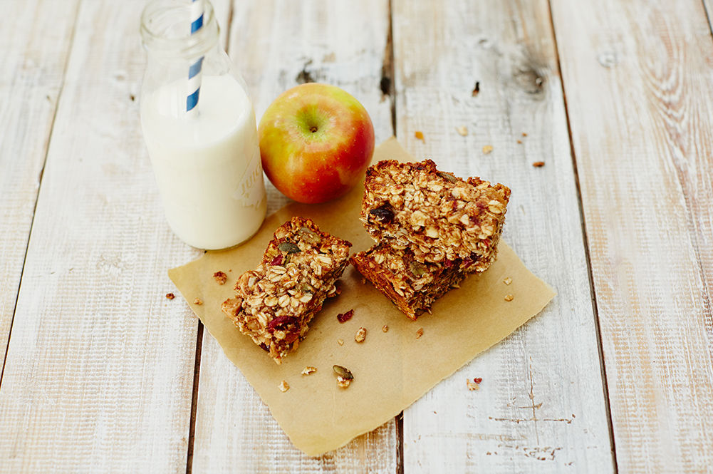 milk with granola bars and an apple
