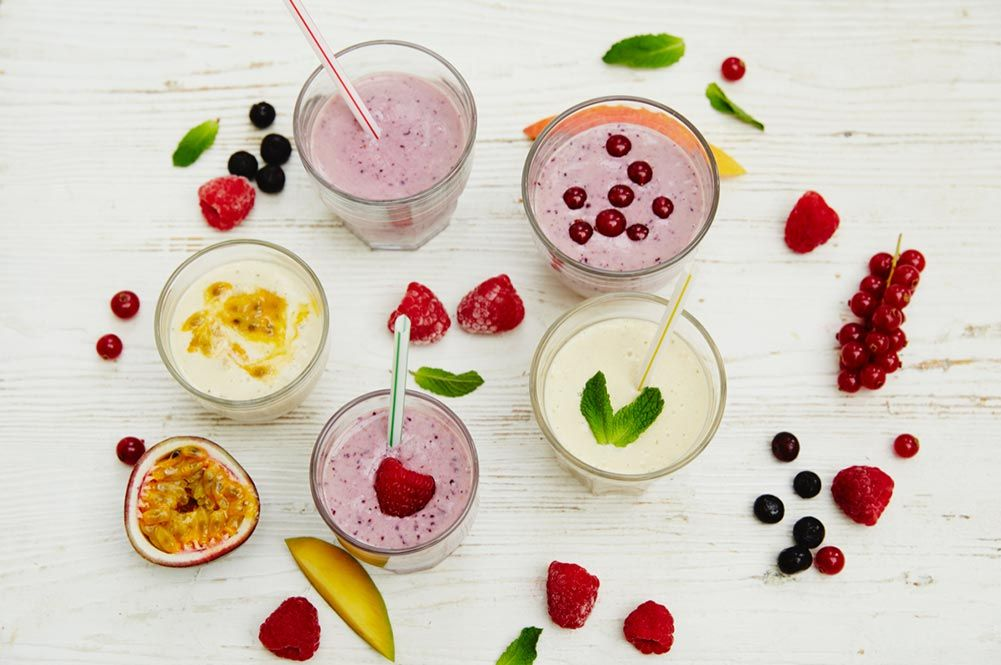 smoothie recipes - an array of drinks surrounded by fruit