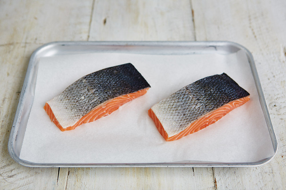 healthy fish - 2 pieces of raw salmon on a tray