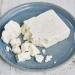 feta cheese in a block, crumbled