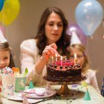 birthday party with chocolate cake and children
