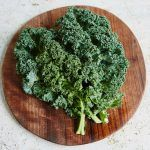 bunch of kale on a chopping board
