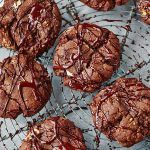 triple chocolate chip cookies with chocolate drizzle on top