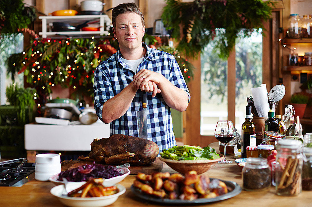 jamie oliver in kitchen at christmas with a christmas roast cooked