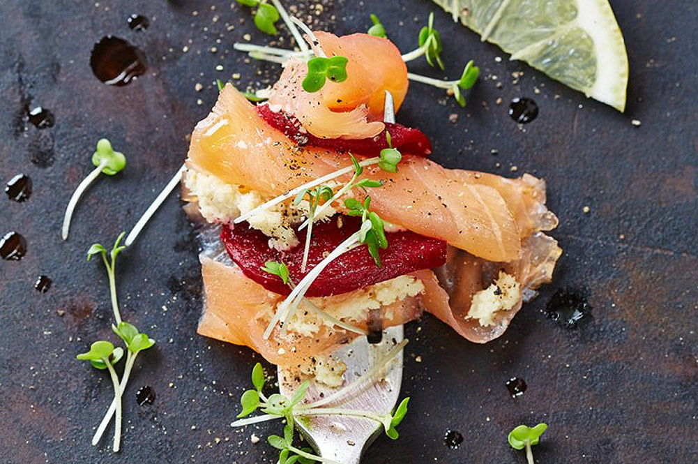 smoked salmon with meat and cress and a slice of lemon