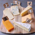 cheeseboard filled with different types of cheese