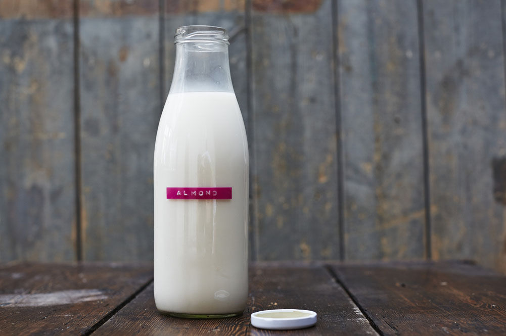 How to make almond milk - bottle of almond milk with label on
